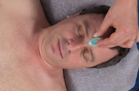 Alternative medicine, therapist using gemstones for lithotherapy